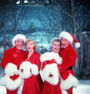 American actors Bing Crosby (1903 - 1977), Rosemary Clooney (1928 - 2002), Vera-Ellen (1921 - 1981), and Danny Kaye (1913 - 1987) sing together, while dressed in fur-trimmed red outfits and standing in front of a stage backrop, in a scene from the film 'White Christmas,' directed by Michael Curtiz, 1954. (Photo by John Swope/The LIFE Images Collection/Getty Images)