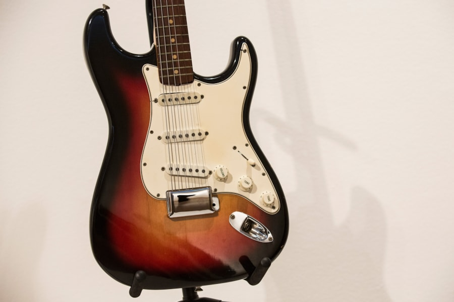 """NEW YORK, NY - NOVEMBER 25:  The Fender Stratocaster electric guitar played by musician Bob Dylan on July 25, 1965 at Newport Folk Festival, better known as """"the night Dyan went electric"""" is seen at an auction preview at Christie's on November 25, 2013 in New York City. The guitar is estimated at $300,000 to $500,000."""