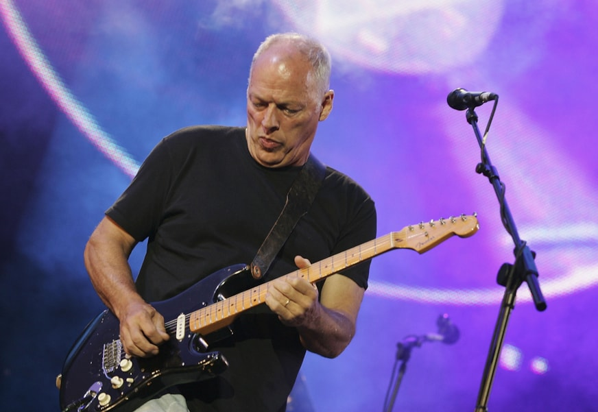 """LONDON - JULY 02:  Dave Gilmour from the band Pink Floyd on stage at """"Live 8 London"""" in Hyde Park on July 2, 2005 in London, England.  The free concert is one of ten simultaneous international gigs including Philadelphia, Berlin, Rome, Paris, Barrie, Tokyo, Cornwall, Moscow and Johannesburg. The concerts precede the G8 summit (July 6-8) to raising awareness for MAKEpovertyHISTORY."""