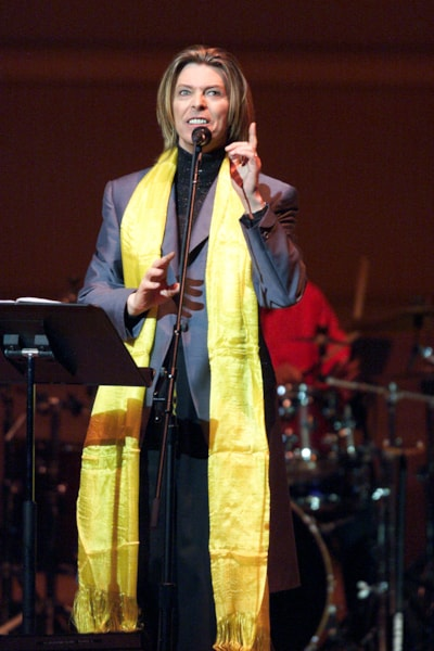 David Bowie on stage performing during the Tibet House Benefit Concert 2001 with artistic director Philip Glass, Dana Bryant, Emmylou Harris, Patti Smith, David Bowie, Nawang Khechog, Natalie Merchant, Moby, Rahat Nusrat Fateh Ali Khan and the Drepung Gomang Tibetan Monks at Carnegie Hall in New York City, New York on Monday February 26, 2001. (photo by Gabe Palacio/ImageDirect)