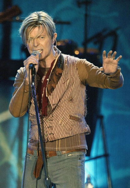 MANCHESTER, ENGLAND - NOVEMBER 17: David Bowie performs on the first night of his UK tour at the MEN Arena on November 17, 2003 in Manchester, England. (Photo by Alex Livesey/Getty Images)