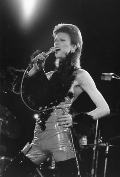 David Bowie (1947 - 2016) performing at a live recording of 'The 1980 Floor Show' for the NBC 'Midnight Special' TV show, at The Marquee Club in London, with a specially invited audience of Bowie fanclub members, 20th October 1973. Bowie is wearing his 'Angel of Death' costume. (Photo by Jack Kay/Daily Express/Getty Images)
