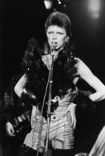 20th October 1973:  David Bowie performing in his 'Angel of Death' costume at a live recording for a Midnight Special TV show made at The Marquee Club in London to a specially invited audience of Bowie fanclub members.  (Photo by Jack Kay/Express/Getty Images)