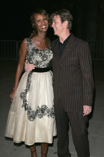 NEW YORK - APRIL 20: Model Iman and musician David Bowie arrive at the Vanity Fair party for the Tribeca Film Festival April 20, 2005 in New York City. (Photo by Peter Kramer/Getty Images)