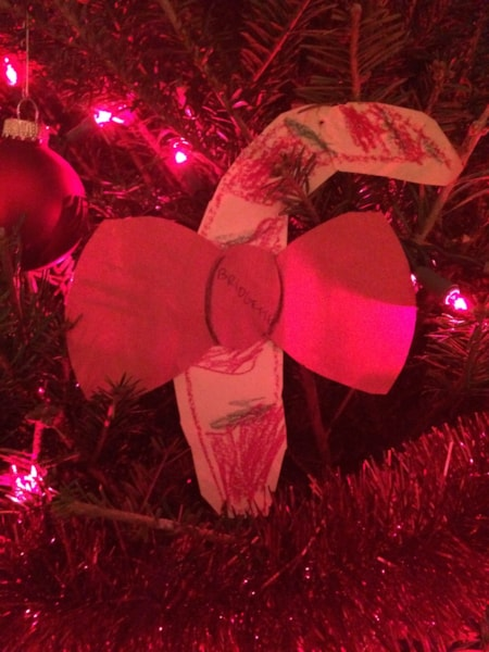 """Another beloved """"ornament"""". My daughter made this one in kindergarten. The teacher misspelled her name (no """"d"""" in her name)."""