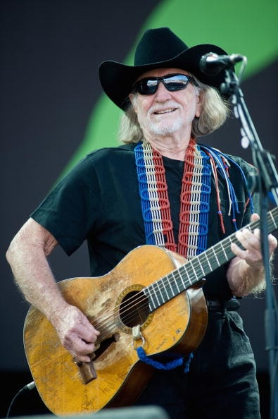 GLASTONBURY, ENGLAND - JUNE 25:  Willie Nelson performs live on the Pyramid Stage during Day 2 of the Glastonbury Festival on June 25, 2010 in Glastonbury, England. This year sees the 40th anniversary of the festival which was started by a dairy farmer, Michael Evis in 1970 and has grown into the largest music festival in Europe.  (Photo by Ian Gavan/Getty Images)
