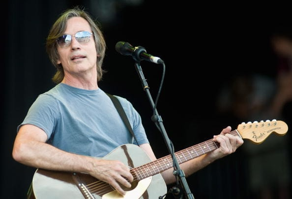 GLASTONBURY, ENGLAND - JUNE 26:  Jackson Browne performs live on the Pyramid Stage during Day 3 of the Glastonbury Festival on June 26, 2010 in Glastonbury, England. This year sees the 40th anniversary of the festival which was started by a dairy farmer, Michael Evis in 1970 and has grown into the largest music festival in Europe.  (Photo by Ian Gavan/Getty Images)