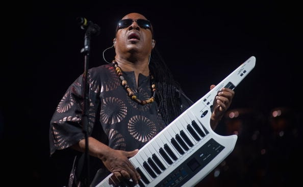 GLASTONBURY, ENGLAND - JUNE 27:  Stevie Wonder performs on The Pyramid Stage during Day 4 of the Glastonbury Festival on June 27, 2010 in Glastonbury, England. This year sees the 40th anniversary of the festival which was started by a dairy farmer, Michael Evis in 1970 and has grown into the largest music festival in Europe.  (Photo by Ian Gavan/Getty Images)