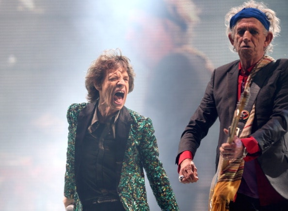 GLASTONBURY, ENGLAND - JUNE 29:  Sir Mick Jagger (L) and Keith Richards of The Rolling Stones perform on the Pyramid Stage at Glastonbury Festival 2013 on June 29, 2013 in Glastonbury, England.  (Photo by Matt Cardy/Getty Images)
