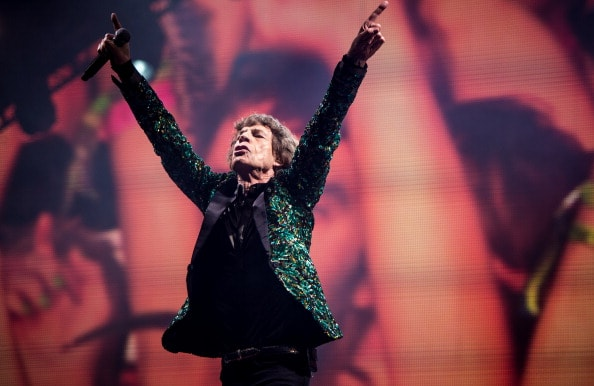 GLASTONBURY, ENGLAND - JUNE 29: Sir Mick Jagger of The Rolling Stones performs  on the Pyramid Stage during day 3 of the 2013 Glastonbury Festival at Worthy Farm on June 29, 2013 in Glastonbury, England. (Photo by Ian Gavan/Getty Images)