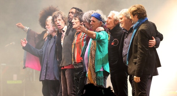 GLASTONBURY, ENGLAND - JUNE 29: The Rolling Stones and guests perform on the Pyramid Stage at Glastonbury Festival 2013 on June 29, 2013 in Glastonbury, England. at the Glastonbury Festival of Contemporary Performing Arts site at Worthy Farm, Pilton on June 29, 2013 near Glastonbury, England. The wholesale market caters for traders throughout the Festival who are estimated to provide 3 million meals for festival-goers, crew and performers. Gates opened on Wednesday at the Somerset diary farm that will be playing host to one of the largest music festivals in the world and this year features headline acts Artic Monkeys, Mumford and Sons and the Rolling Stones. Tickets to the event which is now in its 43rd year sold out in minutes and that was before any of the headline acts had been confirmed. The festival, which started in 1970 when several hundred hippies paid 1 GBP to watch Marc Bolan, now attracts more than 175,000 people over five days.  (Photo by Matt Cardy/Getty Images)