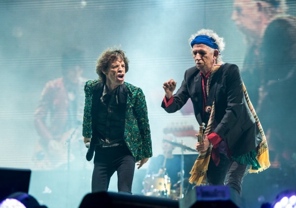 GLASTONBURY, ENGLAND - JUNE 29: Sir Mick Jagger and Keith Richards of The Rolling Stones perform on the Pyramid Stage during day 3 of the 2013 Glastonbury Festival at Worthy Farm on June 29, 2013 in Glastonbury, England. (Photo by Ian Gavan/Getty Images)