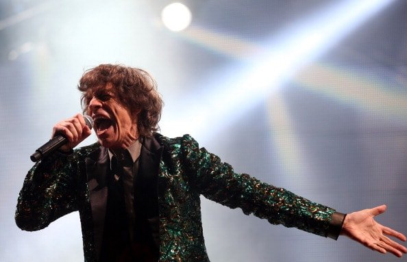 GLASTONBURY, ENGLAND - JUNE 29:  Mick Jagger of The Rolling Stones performs on the Pyramid Stage at the Glastonbury Festival of Contemporary Performing Arts site at Worthy Farm, Pilton on June 29, 2013 near Glastonbury, England. The wholesale market caters for traders throughout the Festival who are estimated to provide 3 million meals for festival-goers, crew and performers. Gates opened on Wednesday at the Somerset diary farm that will be playing host to one of the largest music festivals in the world and this year features headline acts Artic Monkeys, Mumford and Sons and the Rolling Stones. Tickets to the event which is now in its 43rd year sold out in minutes and that was before any of the headline acts had been confirmed. The festival, which started in 1970 when several hundred hippies paid 1 GBP to watch Marc Bolan, now attracts more than 175,000 people over five days.  (Photo by Matt Cardy/Getty Images)