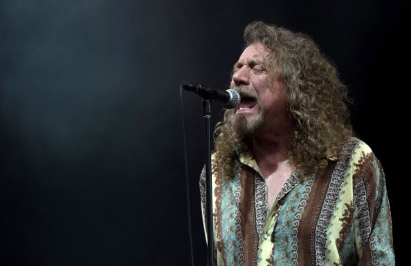 GLASTONBURY, ENGLAND - JUNE 28: Robert Plant performs on the Pyramid Stage during day 2 of the Glastonbury Festival at Worthy Farm on June 28, 2014 in Glastonbury, England.  (Photo by Ian Gavan/Getty Images)