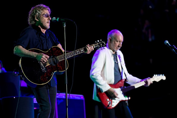 GLASTONBURY, ENGLAND - JUNE 28:  Roger Daltry and Pete Townshend of The Who performs on the Pyramid Stage at the Glastonbury Festival at Worthy Farm, Pilton on June 28, 2015 in Glastonbury, England.  Now its 45th year the festival is one largest music festivals in the world and this year features headline acts Florence and the Machine, Kanye West and The Who. The Festival, which Michael Eavis started in 1970 when several hundred hippies paid just £1, now attracts more than 175,000 people.  (Photo by Ian Gavan/Getty Images)