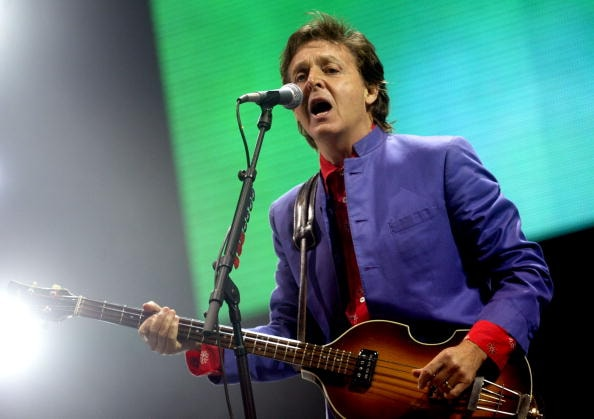 SOMERSET, ENGLAND - JUNE 26:  Paul McCartney performs on the Pyramid stage at Worthy Farm, Pilton, Somerset, at the 2004 Glastonbury Festival June 26, 2004. The festival spans over 3 days and runs until June 27.   (Photo by Matt Cardy/Getty Images)