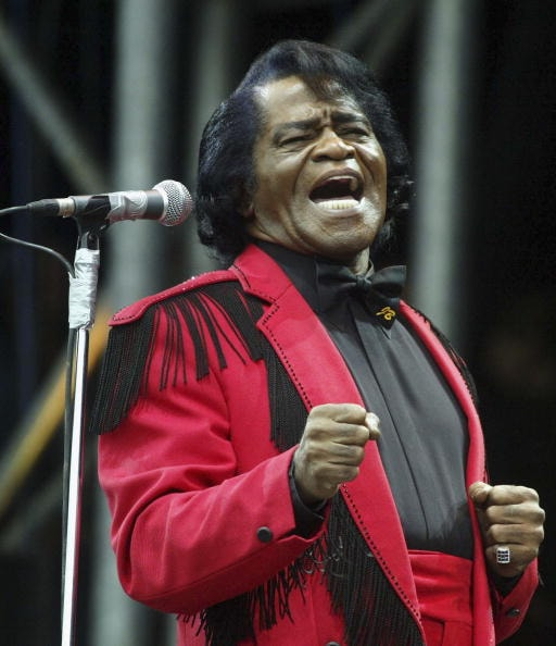 SOMERSET, ENGLAND - JUNE 27:  James Brown on the Pyramid Stage during the third and final day of the Glastonbury Festival 2004 at Worthy Farm, Pilton on June 27, 2004 in Somerset, England. The festival spanned over 3 days. (Photo by Matt Cardy/Getty Images)
