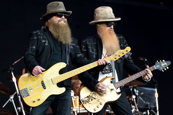 GLASTONBURY, ENGLAND - JUNE 24:  (L-R) Dusty Hill and Billy Gibbons of ZZ Top perform on the Pyramid Stage during the Glastonbury Festival at Worthy Farm, Pilton on June 24, 2016 in Glastonbury, England.  Now its 46th year the festival is one largest music festivals in the world and this year features headline acts Muse, Adele and Coldplay. The Festival, which Michael Eavis started in 1970 when several hundred hippies paid just £1, now attracts more than 175,000 people.  (Photo by Ian Gavan/Getty Images)