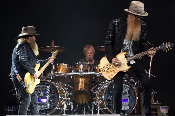 GLASTONBURY, ENGLAND - JUNE 24:  (L-R) Dusty Hill, Frank Beard and Billy Gibbons of ZZ Top perform on the Pyramid Stage during the Glastonbury Festival at Worthy Farm, Pilton on June 24, 2016 in Glastonbury, England.  Now its 46th year the festival is one largest music festivals in the world and this year features headline acts Muse, Adele and Coldplay. The Festival, which Michael Eavis started in 1970 when several hundred hippies paid just £1, now attracts more than 175,000 people.  (Photo by Ian Gavan/Getty Images)