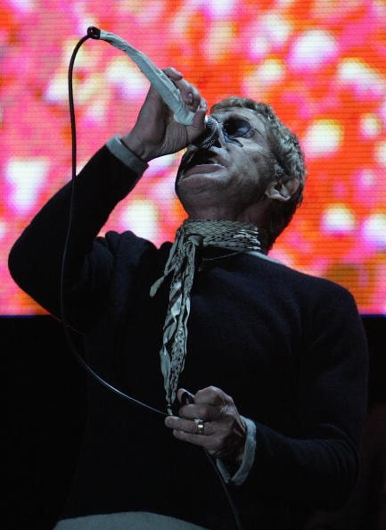GLASTONBURY, UNITED KINGDOM - JUNE 24:  Roger Daltrey of The Who performs on the Pyramid Stage at Worthy Farm, Pilton near Glastonbury, on June 24 2007 in Somerset, England. The festival, that was started by dairy farmer Michael Eavis in 1970, has grown into the largest music festival in Europe. This year's festival is the biggest yet and will have headline acts including The Who, The Arctic Monkeys and The Killers.  (Photo by Matt Cardy/Getty Images)