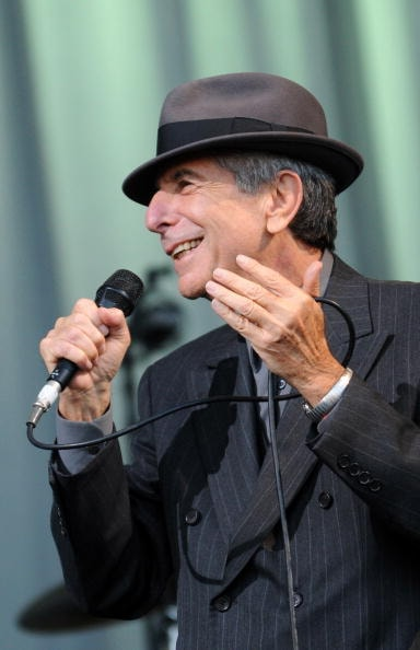 GLASTONBURY, UNITED KINGDOM - JUNE 29:  Leonard Cohen performs on the Pyramid stage during day three of the Glastonbury Festival at Worthy Farm, Pilton on June 29, 2008 in Glastonbury, Somerset, England.  (Photo by Jim Dyson/Getty Images)