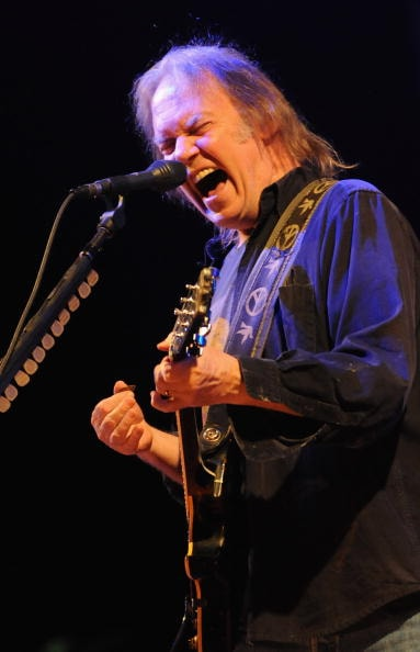 GLASTONBURY, ENGLAND - JUNE 26:  Neil Young performs on the Pyramid Stage during day 2 of the Glastonbury Festival at Worthy Farm in Pilton, on June 26, 2009 in Glastonbury, England.  (Photo by Jim Dyson/Getty Images)