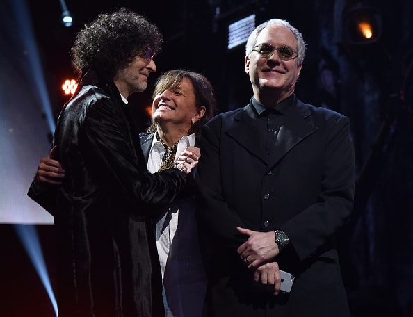 CLEVELAND, OH - APRIL 14:  Howard Stern inducts Richie Sambora and Hugh McDonald of Bon Jovi on stage during the 33rd Annual Rock & Roll Hall of Fame Induction Ceremony at Public Auditorium on April 14, 2018 in Cleveland, Ohio.  (Photo by Theo Wargo/Getty Images For The Rock and Roll Hall of Fame)