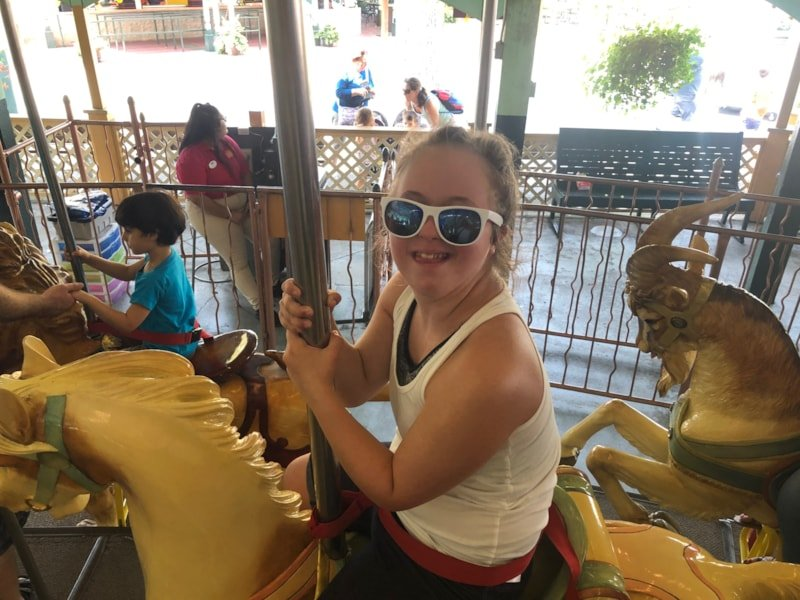 """What a perfect day at Canobie Lake Park. Lucy and I had such an awesome time playing games, riding rides and grabbing lunch. We started at the carousel, which is definitely my speed. Then we headed to the Rowdy Roosters, where we """"took flight"""". (Yes, I was a little scared.) The BEST part of the…"""
