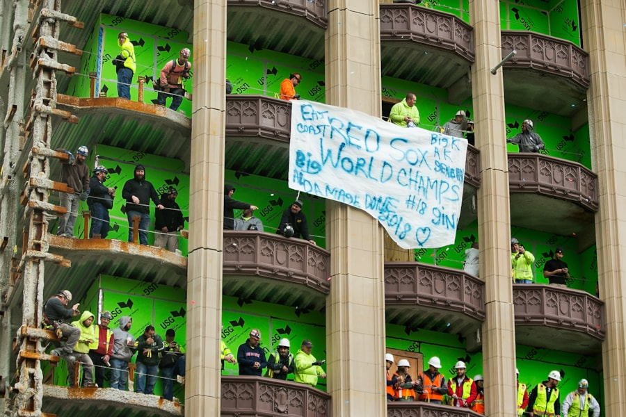 BOSTON, MA - OCTOBER 31:  Construction workers watch from a building during the 2018 World Series victory parade on October 31, 2018 in Boston, Massachusetts. (Photo by Adam Glanzman/Getty Images)