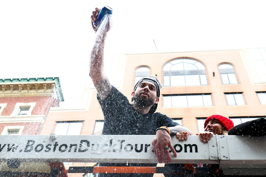 BOSTON, MA - OCTOBER 31:  Blake Swihart #23 of the Boston Red Sox opens a beer can during the 2018 World Series victory parade on October 31, 2018 in Boston, Massachusetts. (Photo by Adam Glanzman/Getty Images)