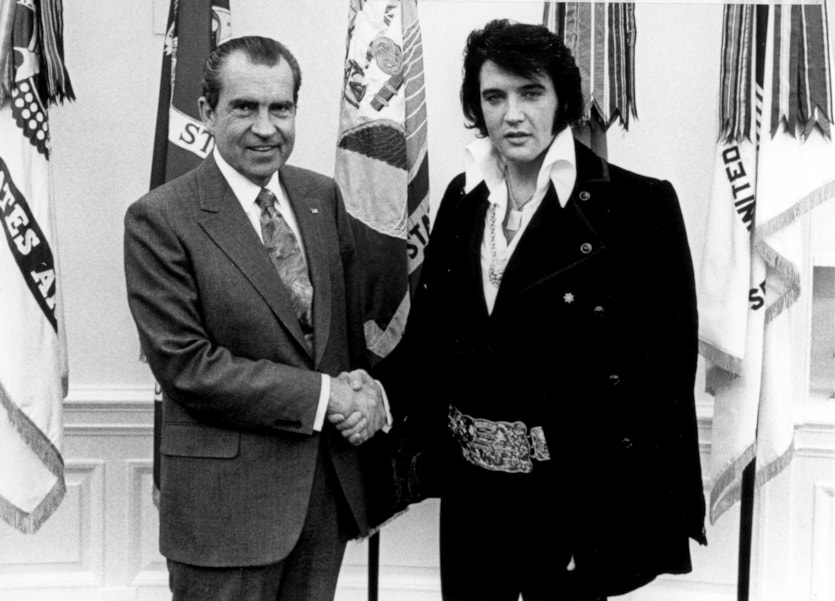 President Richard Nixon meets with Elvis Presley December 21, 1970 at the White House. (Photo by National Archives)
