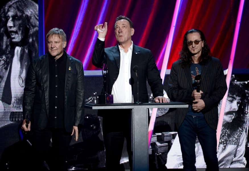 LOS ANGELES, CA - APRIL 18:  (L-R) Inductees Alex Lifeson, Neil Peart and Geddy Lee of Rush speak on stage at the 28th Annual Rock and Roll Hall of Fame Induction Ceremony at Nokia Theatre L.A. Live on April 18, 2013 in Los Angeles, California.  (Photo by Kevin Winter/Getty Images)
