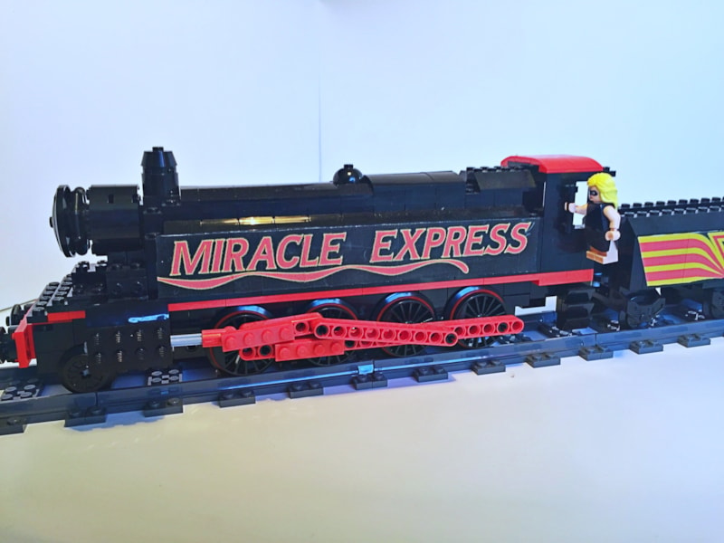 """Queen fans that follow the band on various social media platforms discovered today (February 12) that a new LEGO set has been pitched paying tribute to the band's video for """"Breakthru."""" The Queen Instagram shared a photo of the set along with the caption, """"Support The Queen Miracle Express! Queen fan Adam Hickey has created…"""