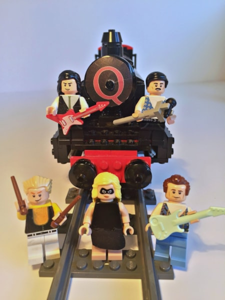 "Queen fans that follow the band on various social media platforms discovered today (February 12) that a new LEGO set has been pitched paying tribute to the band's video for ""Breakthru."" The Queen Instagram shared a photo of the set along with the caption, ""Support The Queen Miracle Express! Queen fan Adam Hickey has created…"