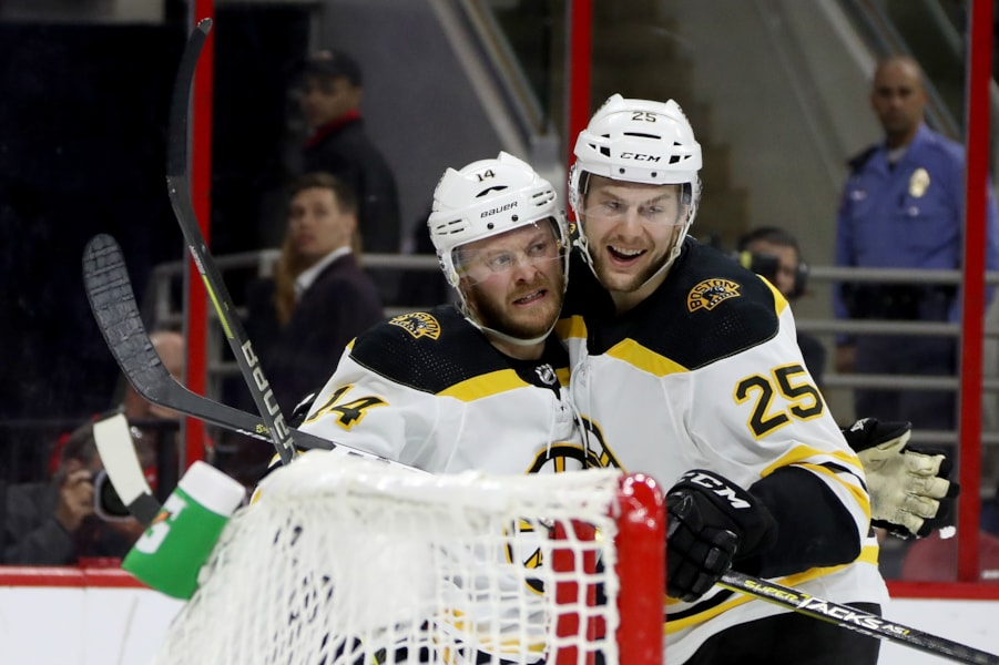 RALEIGH, NORTH CAROLINA - MAY 14: Chris Wagner #14 of the Boston Bruins celebrates with Brandon Carlo #25 after scoring a goal on Curtis McElhinney #35 of the Carolina Hurricanes during the second period in Game Three of the Eastern Conference Finals during the 2019 NHL Stanley Cup Playoffs at PNC Arena on May 14, 2019 in Raleigh, North Carolina. (Photo by Bruce Bennett/Getty Images)