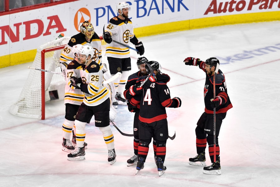 RALEIGH, NORTH CAROLINA - MAY 14: Calvin de Haan #44 of the Carolina Hurricanes celebrates with his teammates after scoring a goal on Tuukka Rask #40 of the Boston Bruins during the second period in Game Three of the Eastern Conference Finals during the 2019 NHL Stanley Cup Playoffs at PNC Arena on May 14, 2019 in Raleigh, North Carolina. (Photo by Grant Halverson/Getty Images)