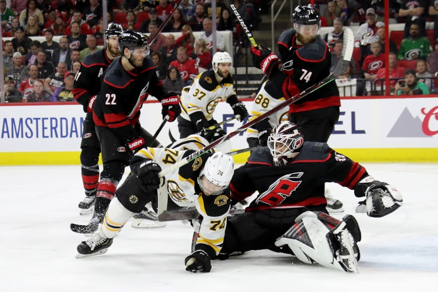 RALEIGH, NORTH CAROLINA - MAY 14: Jake DeBrusk #74 of the Boston Bruins collides with Curtis McElhinney #35 of the Carolina Hurricanes which causes a disallowed Boston Bruins goal during the third period in Game Three of the Eastern Conference Finals during the 2019 NHL Stanley Cup Playoffs at PNC Arena on May 14, 2019 in Raleigh, North Carolina. (Photo by Bruce Bennett/Getty Images)