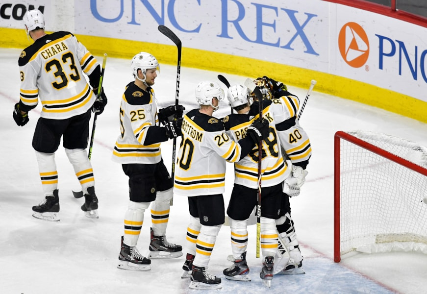 RALEIGH, NORTH CAROLINA - MAY 14: Tuukka Rask #40 of the Boston Bruins celebrates with his teammates after defeating the Carolina Hurricanes in Game Three of the Eastern Conference Finals during the 2019 NHL Stanley Cup Playoffs at PNC Arena on May 14, 2019 in Raleigh, North Carolina. (Photo by Grant Halverson/Getty Images)