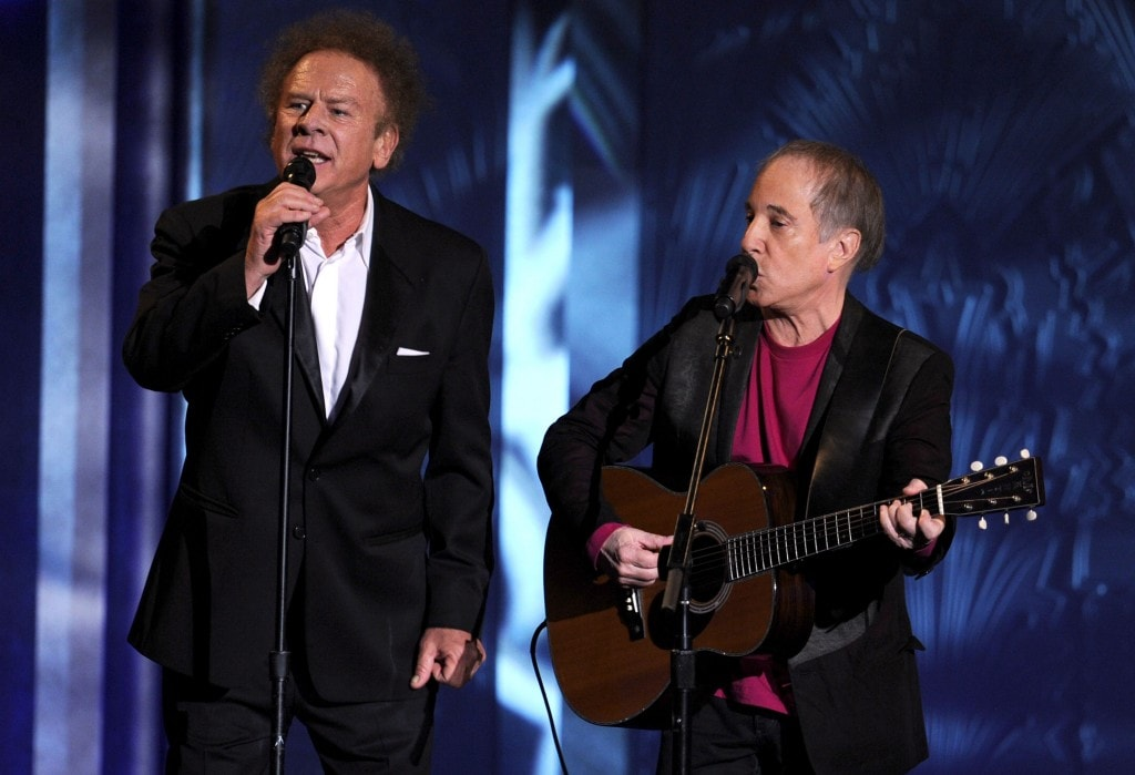 CULVER CITY, CA - JUNE 10:  Musicians Art Garfunkel (L) and Paul Simon of Simon & Garfunkel perform onstage during the 38th AFI Life Achievement Award honoring Mike Nichols held at Sony Pictures Studios on June 10, 2010 in Culver City, California. The AFI Life Achievement Award tribute to Mike Nichols will premiere on TV Land on Saturday, June 25 at 9PM ET/PST.  (Photo by Kevin Winter/Getty Images for AFI)