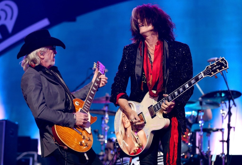 LAS VEGAS, NV - SEPTEMBER 22:  Guitarists Brad Whitford (L) and Joe Perry of Aerosmith perform onstage during the 2012 iHeartRadio Music Festival at the MGM Grand Garden Arena on September 22, 2012 in Las Vegas, Nevada.  (Photo by Christopher Polk/Getty Images for Clear Channel)