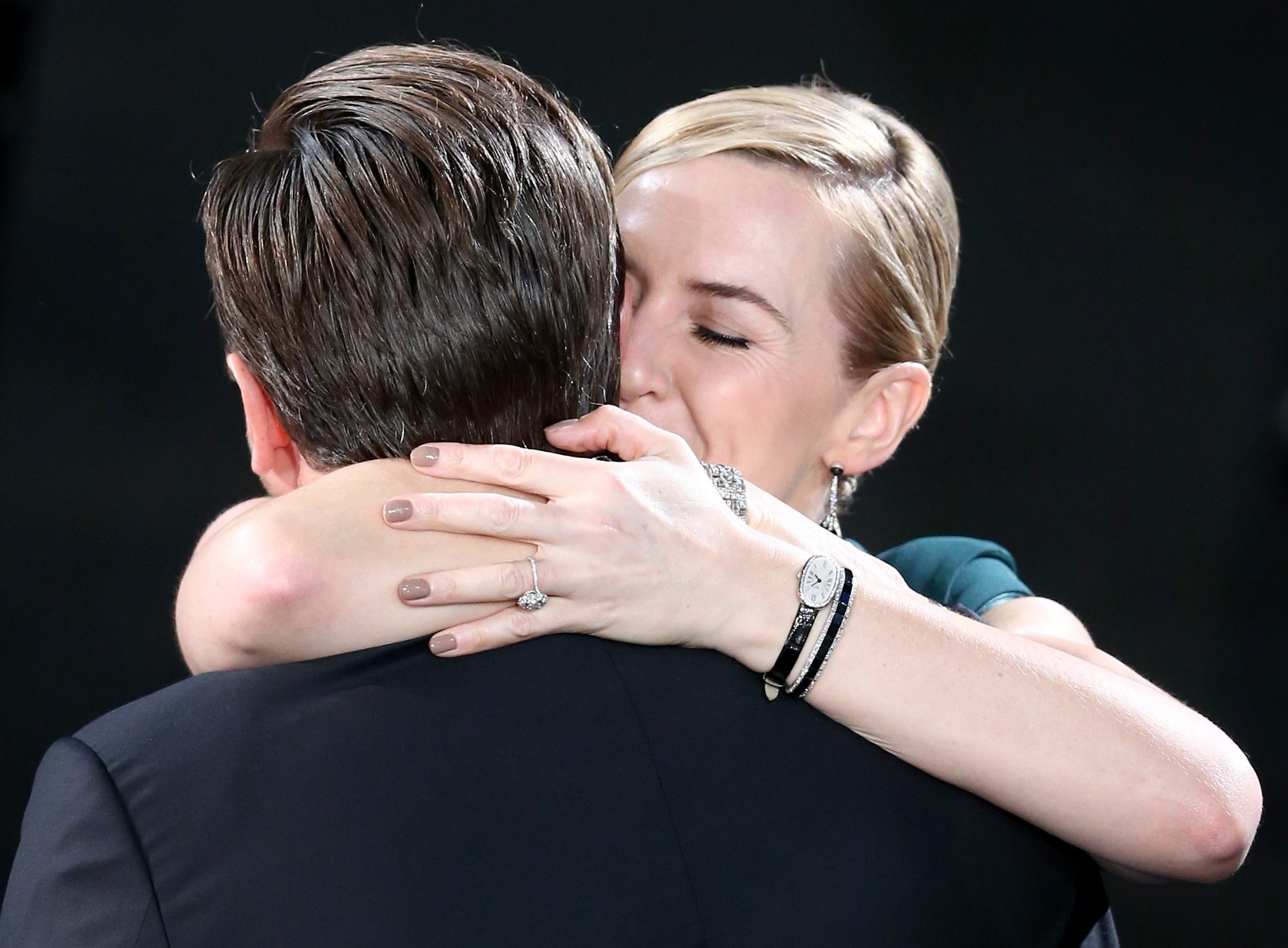 Kate Winslet (R) congratulates Actor Leonardo DiCaprio (Photo by Christopher Polk/Getty Images for Turner)