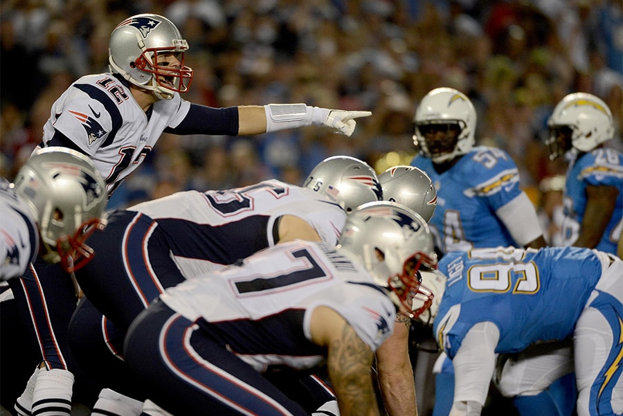SAN DIEGO, CA- DECEMBER 7: Tom Brady #12 of the New England Patriots calls a play at the line of scrimmage against the San Diego Chargers during an NFL game at Qualcomm Stadium on December 7, 2014 in San Diego, California. (Photo by Donald Miralle/Getty Images)
